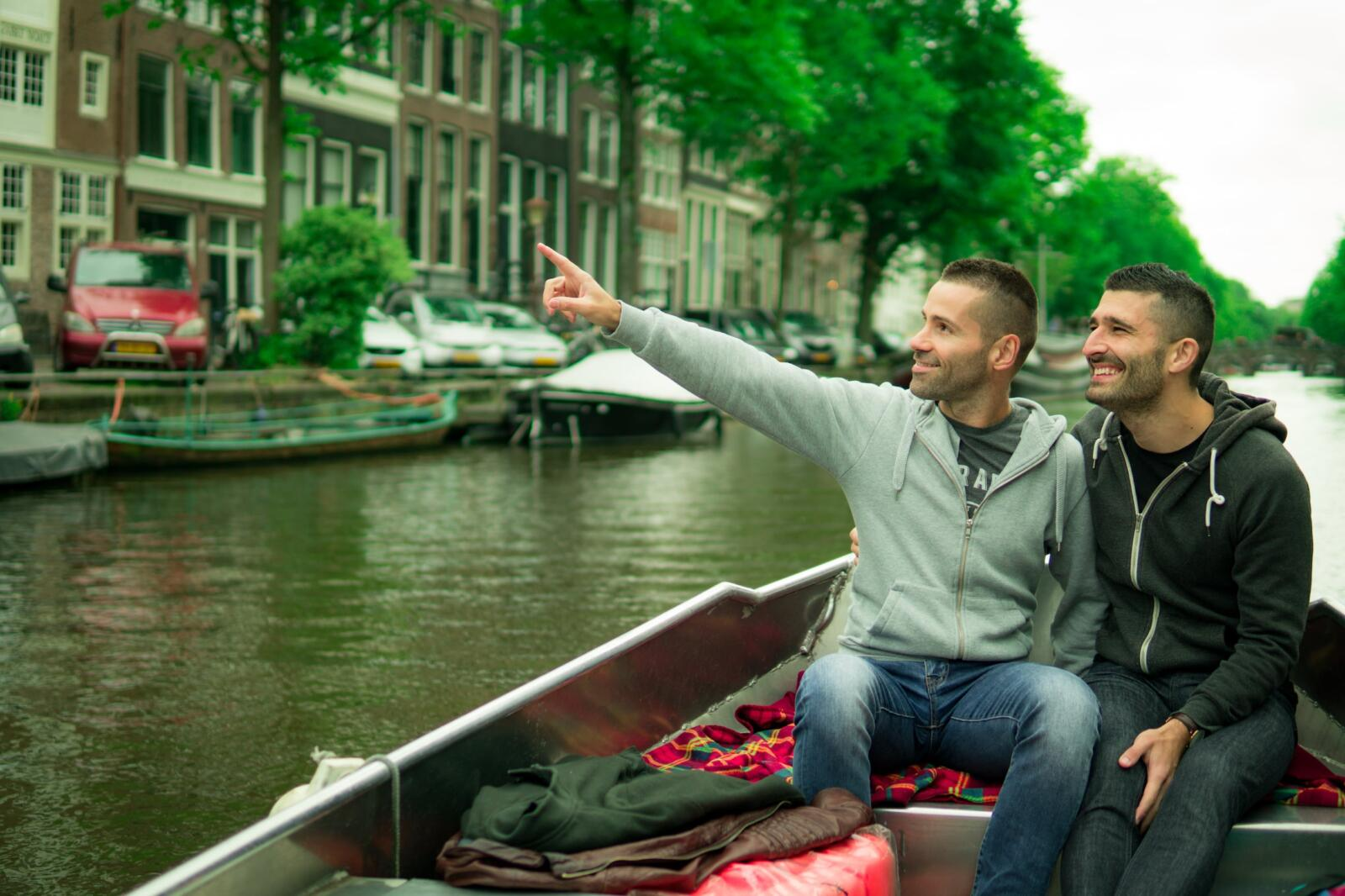 Gay couple in Amsterdam romantic boat ride