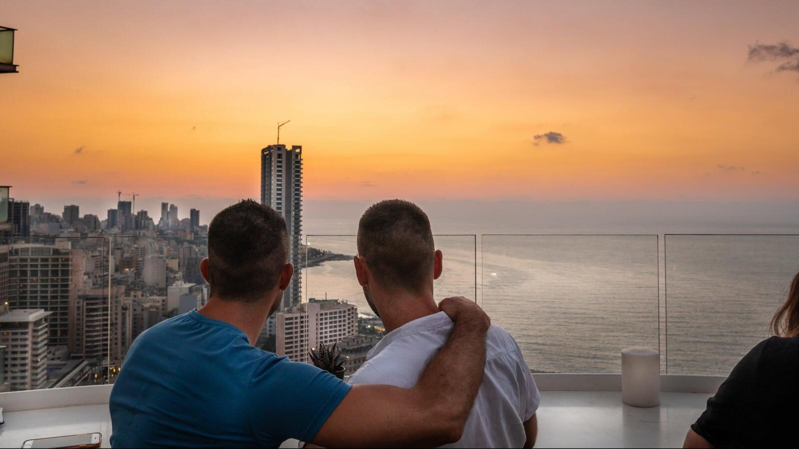 Gay couple in Beirut enjoying the sunset at a rooftop bar