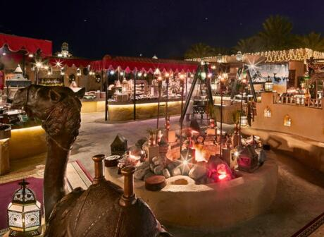 Experience traditional Arabic food and entertainment at Al Hadheerah in Dubai.