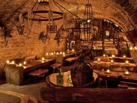 Gay dining in Prague - a medieval dinner in a tavern is an awesome foodie experience.