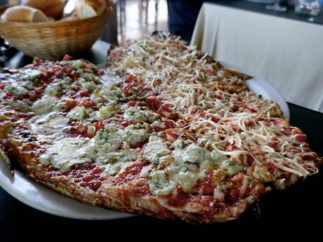 A fish pizza - boga fish specialty at the famous Escauriza Restaurant in Rosario