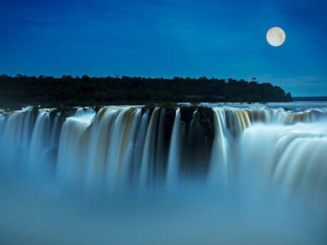 For an incredibly romantic experience, walk to the Iguazu Falls under the light of a full moon!