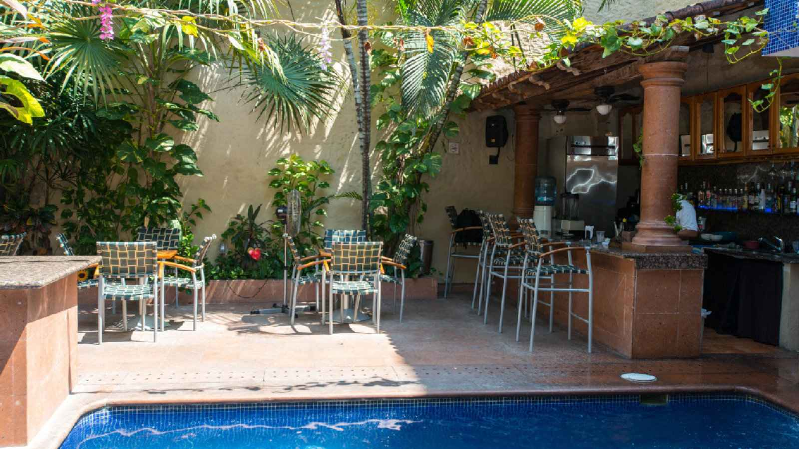 The cute pool at Mercurio Hotel hosts fun gay pool parties in Puerto Vallarta.
