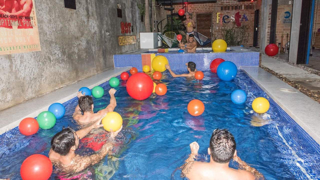 Gay accommodation in Puerto Vallarta - the male-only Pinata PV Gay Hotel is the place to be for fun clothing-optional pool parties!