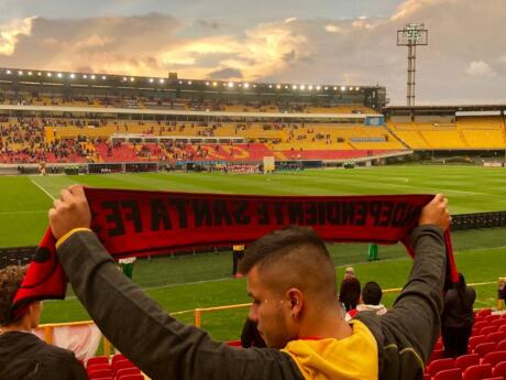 Watch a football match at Bogota's El Campin stadium and enjoy the electric energy of the crowd!