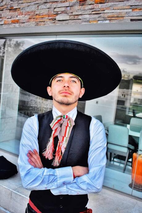 Gay sexy boy with Mexican hat