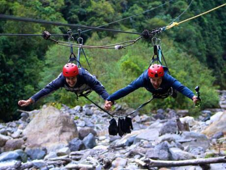 A great couples' activity for gay travellers to Medellin is to go ziplining over the jungle together!