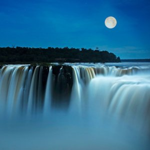 One of the most romantic ways to visit Iguazu Falls is under the light of a full moon.