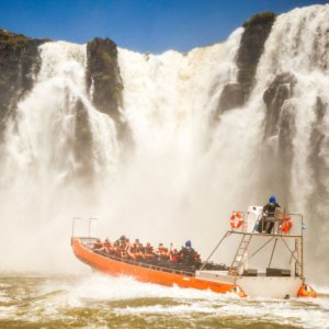 A boat ride under the falls is a thrilling way to experience these incredible cascades.