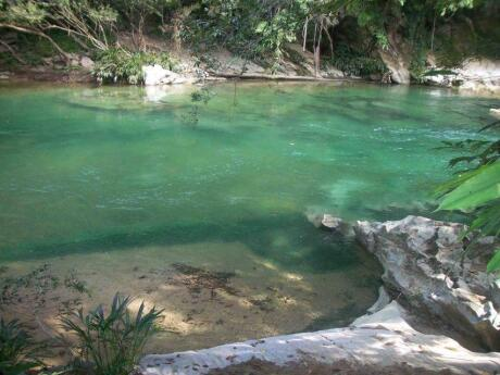 Day trips from Medellin - the Rio Claro nature reserve features crystal clear waters and lots of native wildlife.