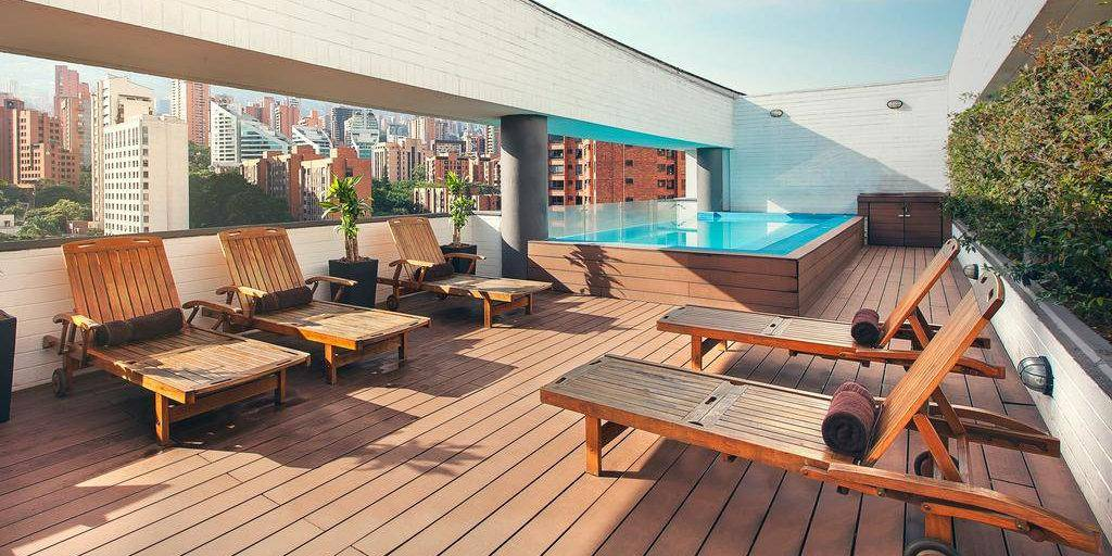 Gay hotels in Medellin - the rooftop pool and lounging area is just one of the pretty features of Medellin's Sites Hotel