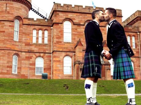 Renting some kilts and frolicking in the grounds of Inverness Castle is a very fun thing for gay travellers to the Scottish Highlands to do!