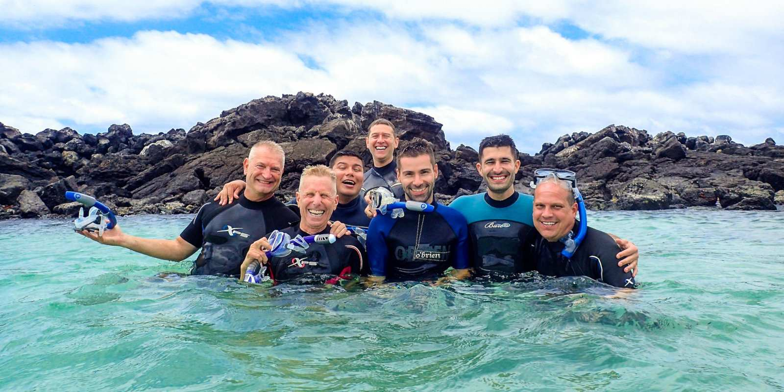 Snorkelling with our new gay friends on an Ecuador Nomadic gay cruise of the Galapagos