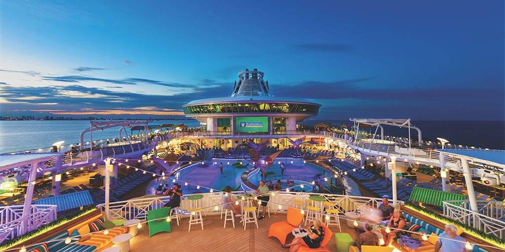 Relax on the pool deck on your way to Miami Pride on this cool gay cruise by Source Events