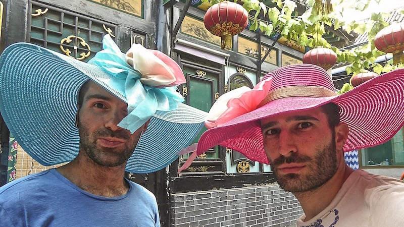 Shopping for Asian inspired hats hats at the Amantis gay shop in Barcelona