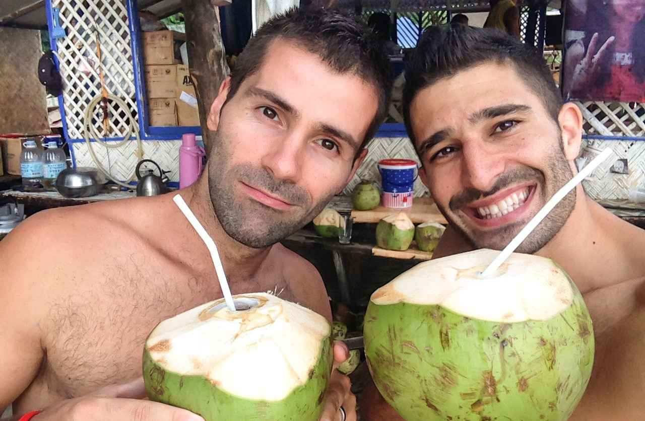 Nomadic Boys drinking a Buko, the famous coconut of the Philippines