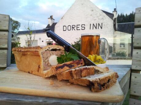 For traditional Scottish food in a gorgeous spot, the Dores Inn beside Loch Ness is a beautiful little pub
