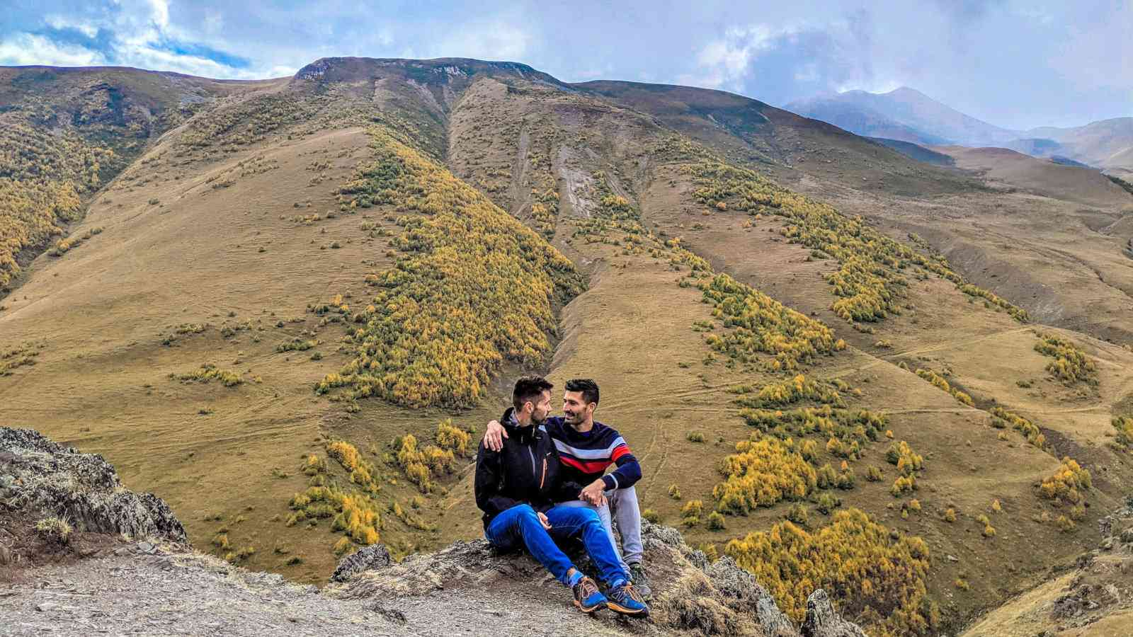 Gay couple trekking in the Kazbegi region of Georgia