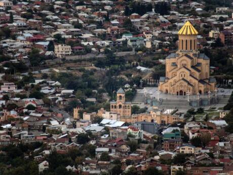 The Holy Trinity Cathedral in Tbilisi is the third-largest church in the world and a must-see while you're in the country