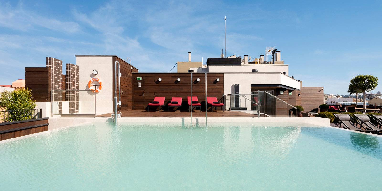 Best gay hotels in Barcelona - the Corner Hotel has a gorgeous rooftop pool and terrace to relax on!