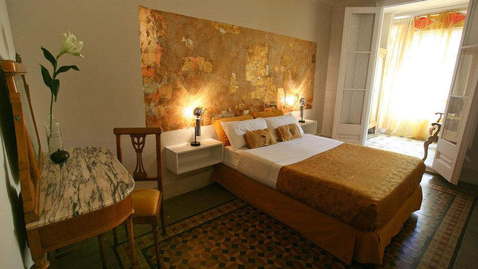 For a budget stay that still feels opulent, you'll love the gold decor at the Vrabac Guesthouse in Barcelona