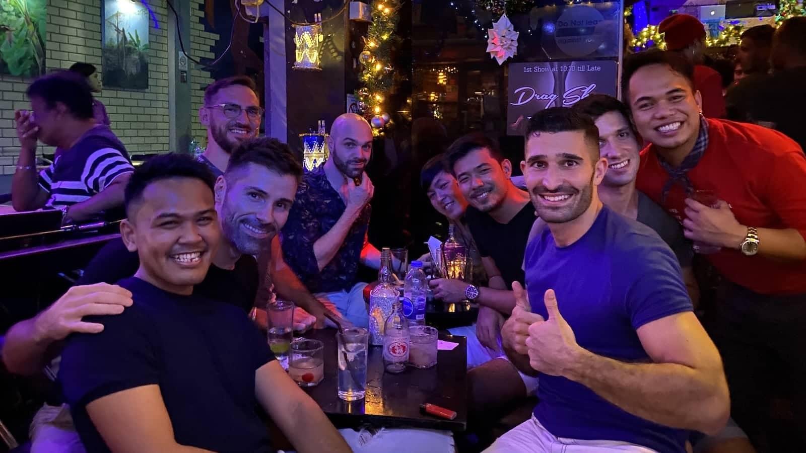 Gay guys having drinks in Bangkok gay scene in Silom Soi 4