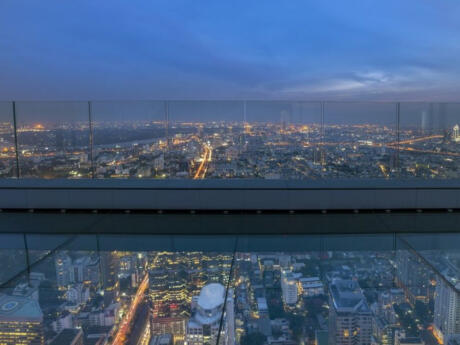 The MahaNakhon tower in Bangkok has a glass floor, amazing views and the highest rooftop bar in Thailand