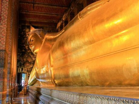 The 46-metre long reclining Buddha covered in gold leaf is another must-visit spot in Bangkok