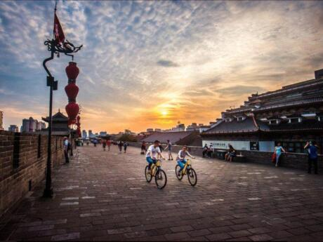 The city walls of Xi'an are the largest and best-preserved ancient city walls in China. You can join a cycling or walking tour to explore the walls and learn more about the city's history