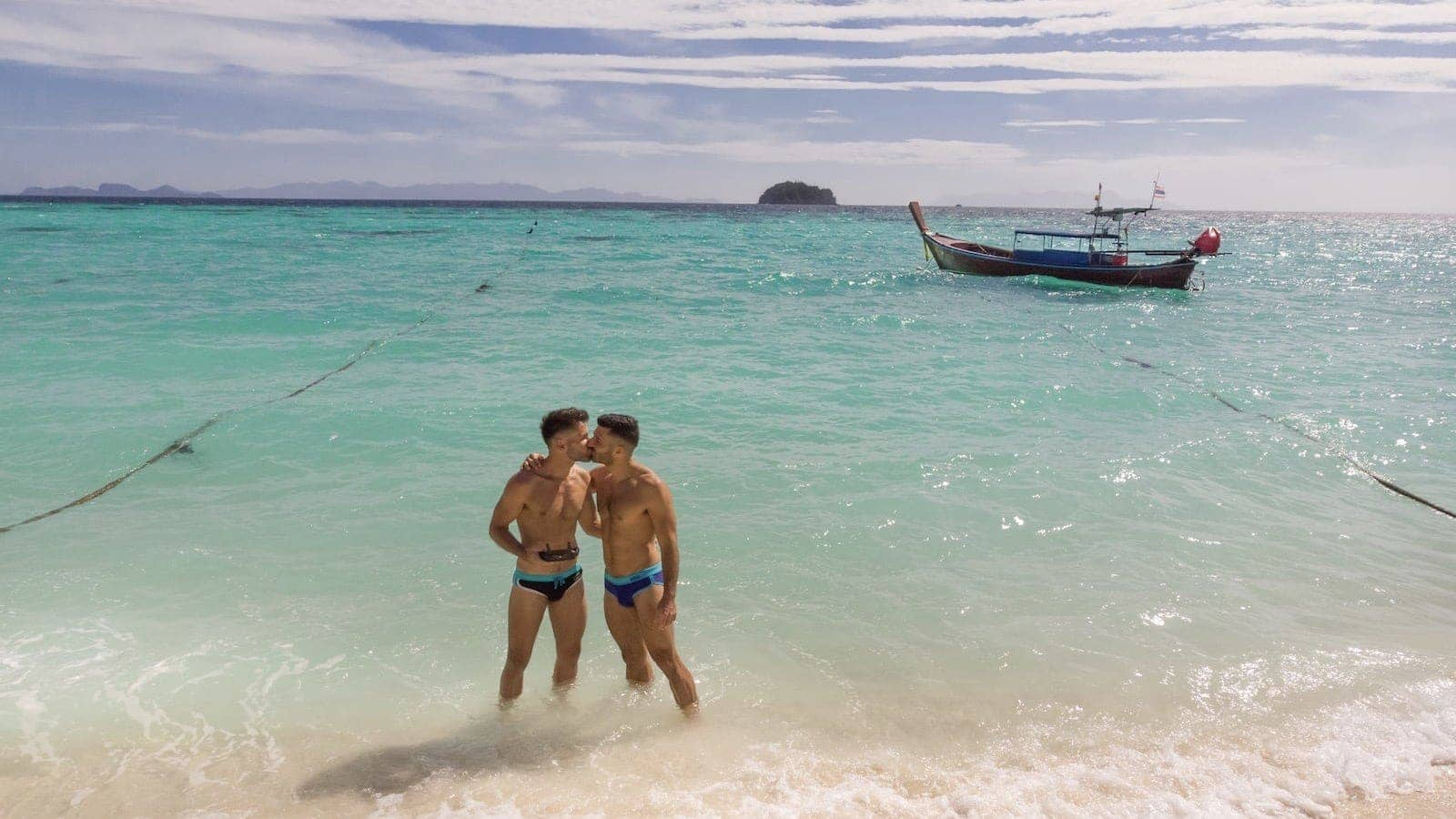 Gay couple kissing in Koh Lipe island in Thailand