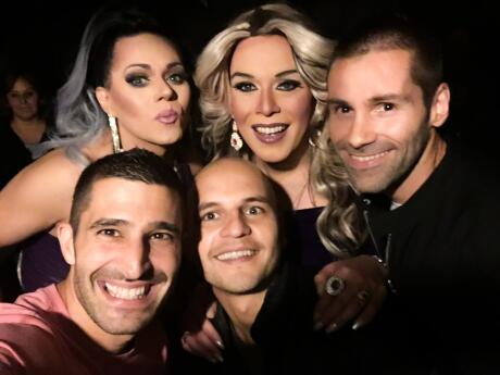 Nomadic Boys hanging out with drag queens at gay bar farinelli in santiago