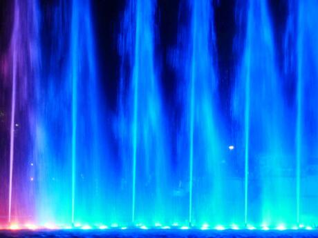 Blue fountain jets during the magic water fountain show in lima