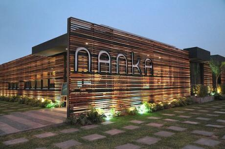 Photo of Nanka restaurant from the outside, beautifully lit up at night