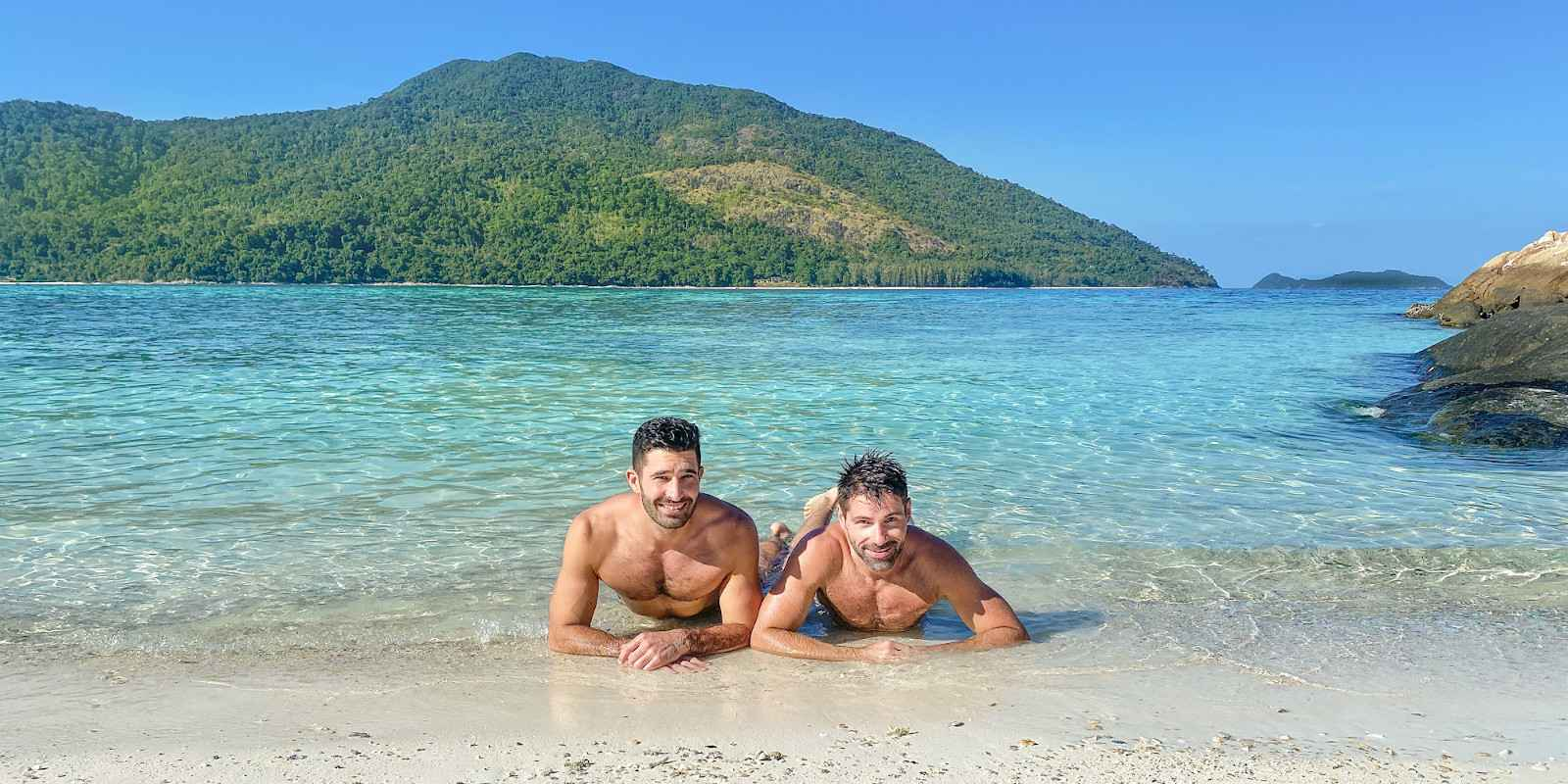 Nomadic Boys Stefan and Sebastien posing on one of the many beautiful gay beaches in Phuket