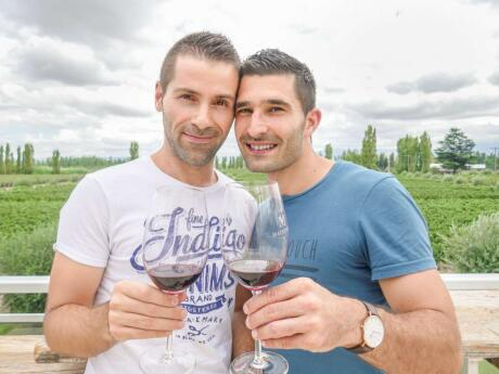 Nomadic Boys, gay couple enjoying a glass of wine