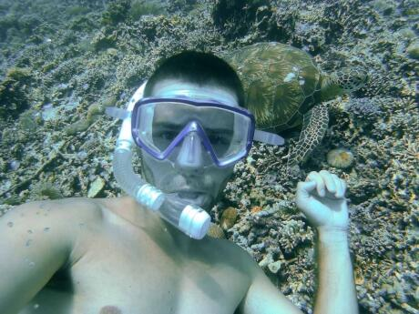 Sebastien snorkelling down to 10 metres to meet this beautiful turtle near Gili T