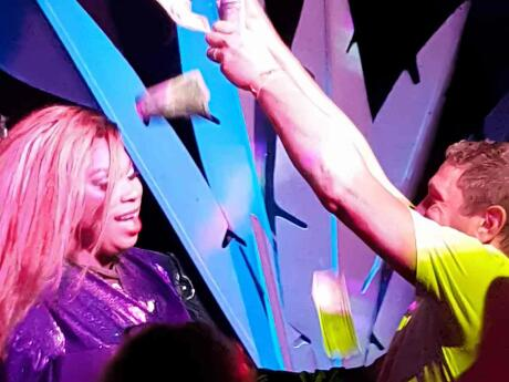 Man and drag queen dancing at gay club 801 bourbon in Key West