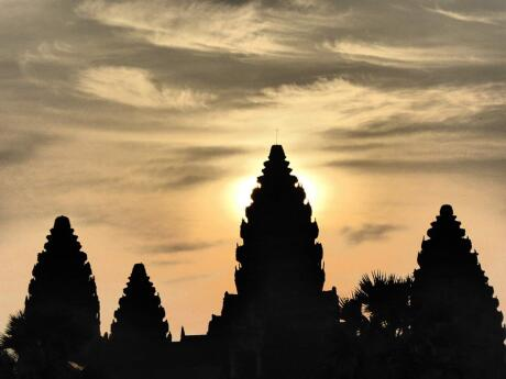 Seeing the sun rise behind the ancient temples of Angkor Wat is an unforgettable experience in Siem Reap