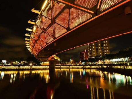 The Love River in Kaohsiung Taiwan is lit up at night and looks very romantic