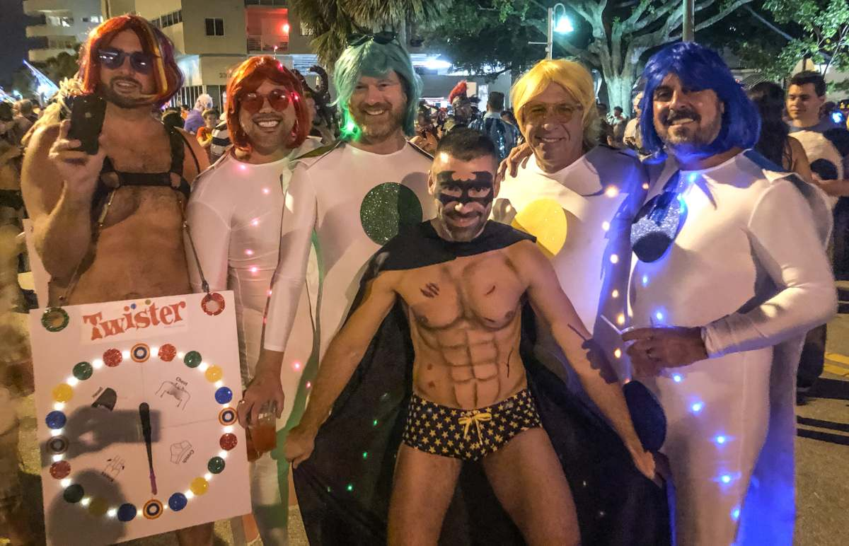 Gay friends dressed as Twister board game