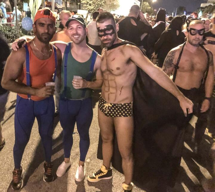 Gay couple dressed as Mario and Luigi for Halloween gay party