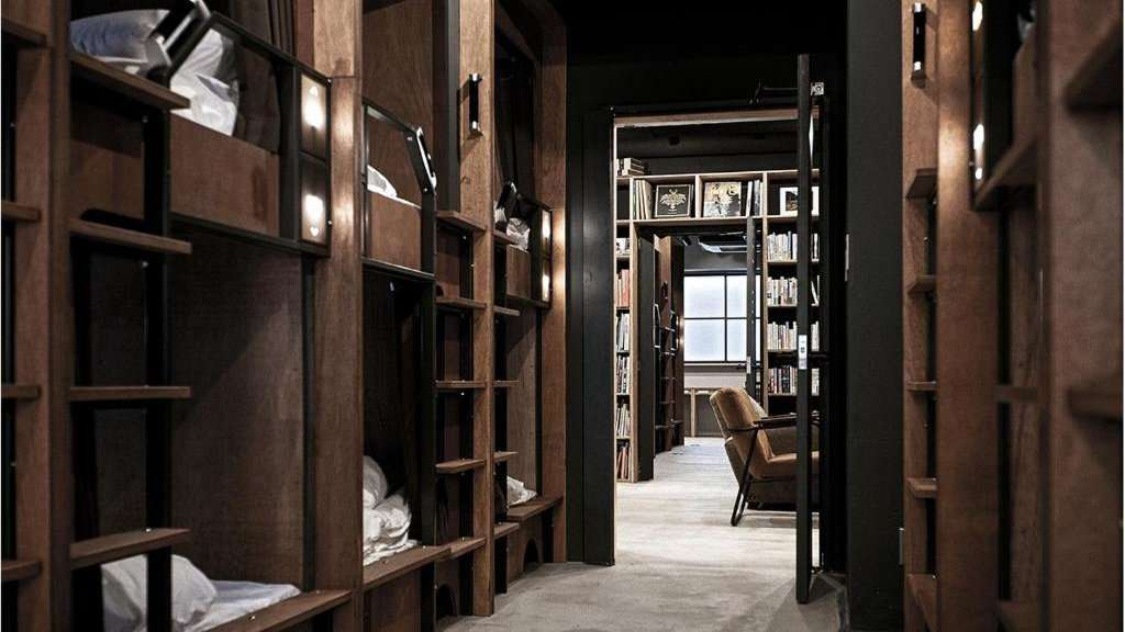 Feel like you're sleeping in a library at the cosy Dorm Hostel in Osaka