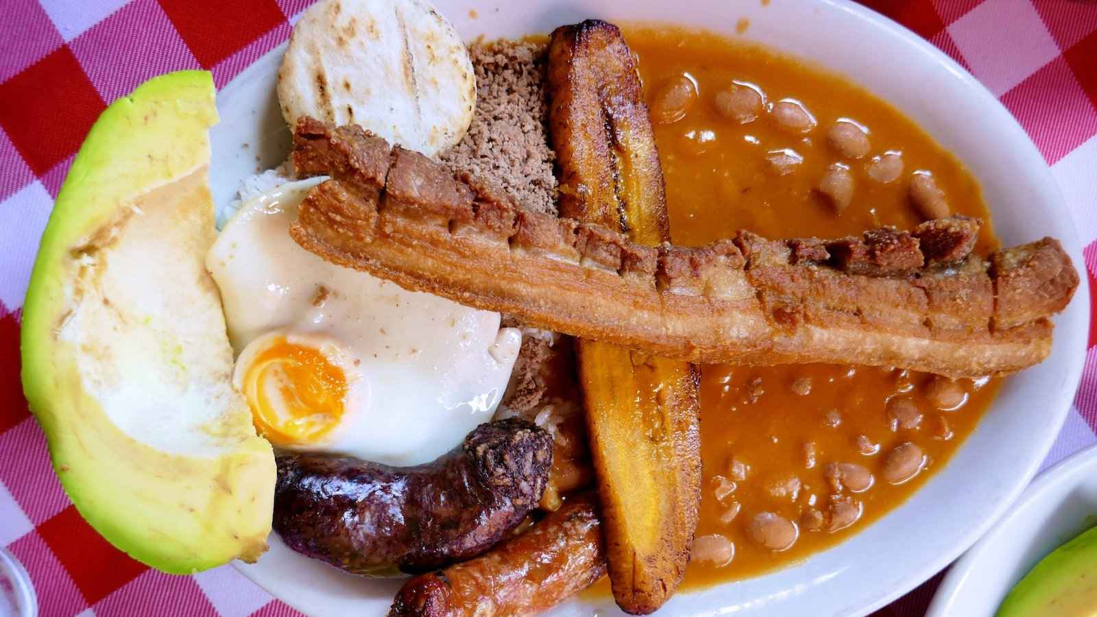 A Colombian Bandeja Paisa is a big plate of food meant to provide energy for an entire day