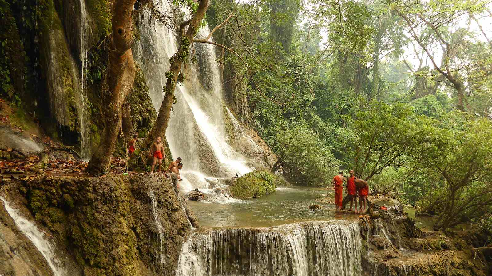 the Kuang Si Falls in Laos is a gorgeous tiered waterfall you need to visit while in the country