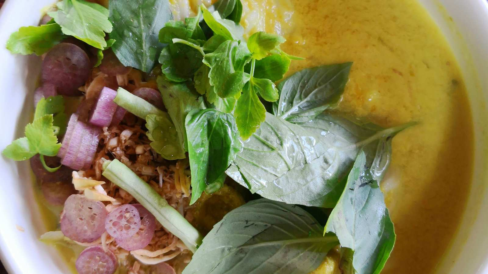 Num banh chok is a delicious noodle dish from Cambodia that's usually served for breakfast