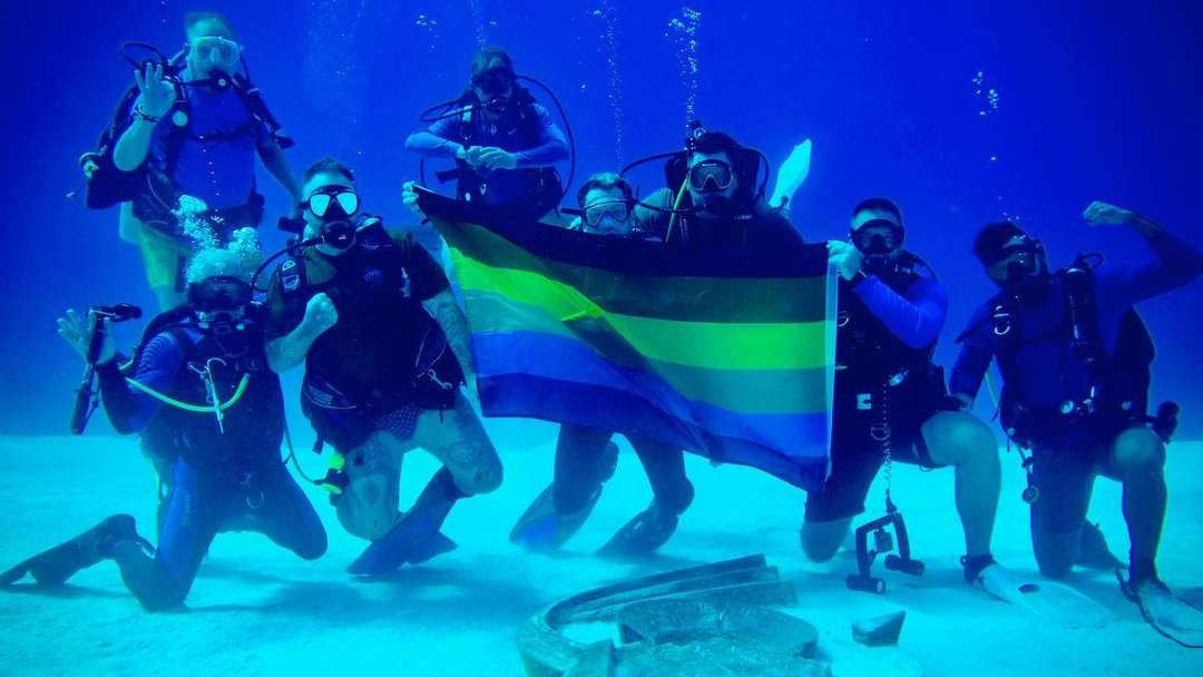"""""""Flying"""" the pride flag in the Sea of Cortez during a gay diving trip"""