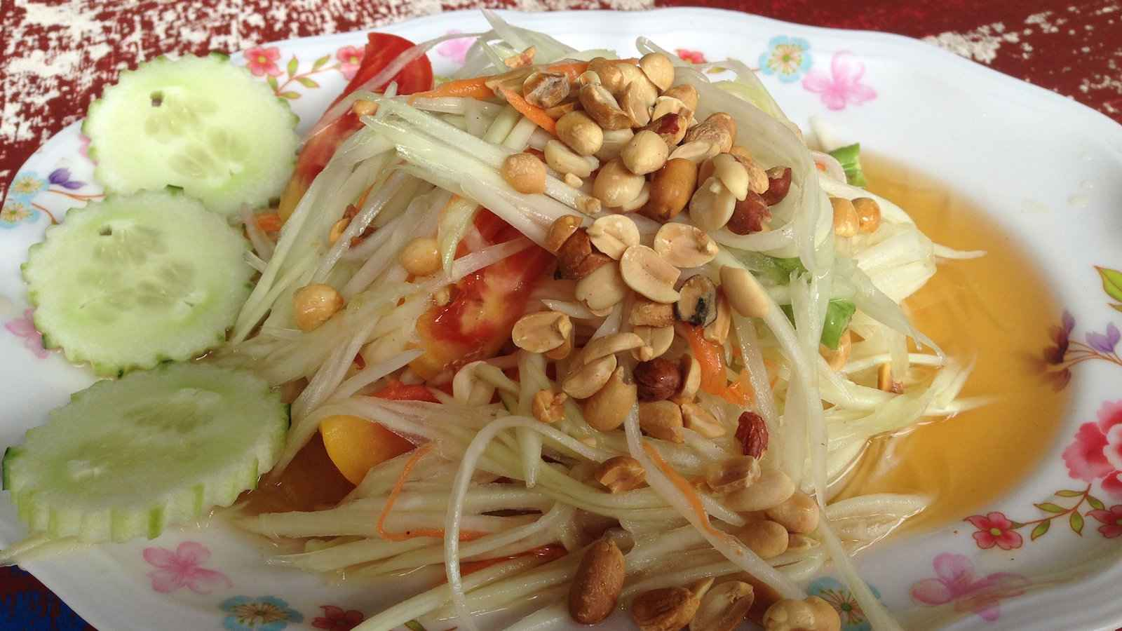 Tam mak hoong is a spicy papaya salad you can find at street food markets in Laos