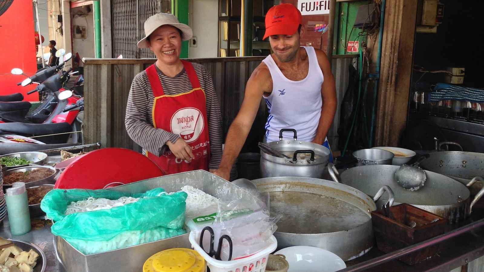 Pho is a Vietnamese dish which spread to Laos where you can try the Laotian version at many street food stalls