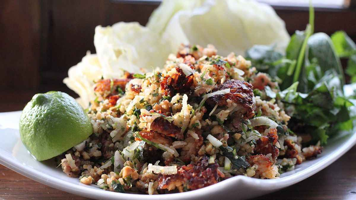 Nam khao is a crispy rice salad from Laos that you can get at street food stalls